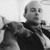 Henze smoking with his dog