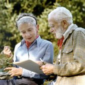 John Jacob Niles, late in life, discussing a manuscript with his wife Rena Niles