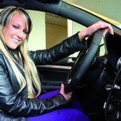 Natalie in her Volkswagen car