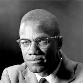 4BywqnvbjJb271448ef3aca30df6-3513398-Malcolm_X_pictured_in_1964_lived_in_the_Boston_home_with_his_hal-a-4_1459245220473.jpg