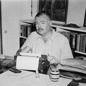 Ernest Hemingway at a typewriter. Finca Vigia, San Francisco de Paula, Cuba.jpg