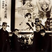u2_in_front_of_sailor_moon_r_poster.jpg
