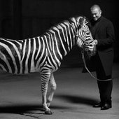 George with a Zebra for 'White Light'