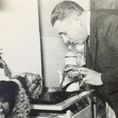 Poulenc cooking with his dog