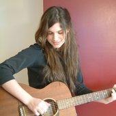 Mariah playing guitar