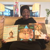 Julie Coker holding her three albums