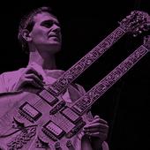 John-McLaughlin-resize-purple-.png